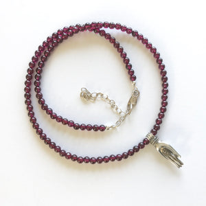 Mala necklace with Om hand and 108 garnet beads
