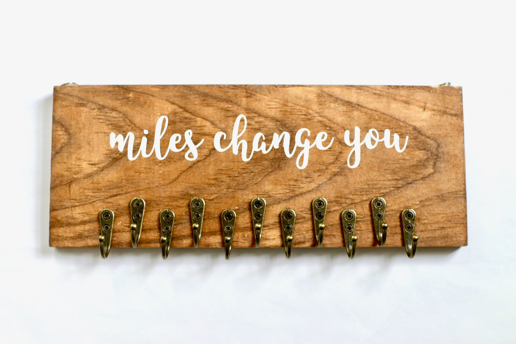 Miles Change You Medal Rack