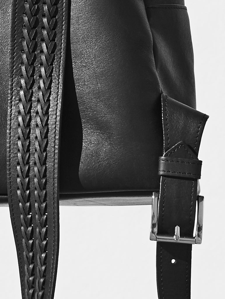 black moon crescent backpack strap weave buckle close up