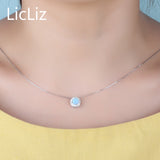 925 Sterling Silver Solitaire Necklace . Blue Fire Opal Pendant Necklace CZ Halo Necklace .
