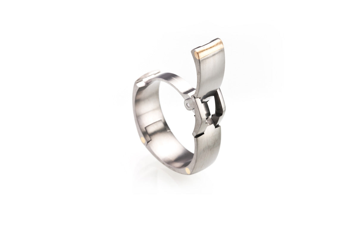 Hinged, Pinch operated, openable ring. U.S. made, Titanium, yellow gold, white gold, rose gold, platinum, and hardened stainless steel wedding ring, toggle-Pull, openable ring
