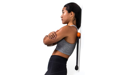 TriggerPoint AcuCurve Cane orange woman doing back massage