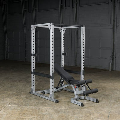 body solid power rack with adjustable bench black and silver simpsons fitness supply