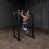 Woman doing pull-ups on PPR400 body solid power rack