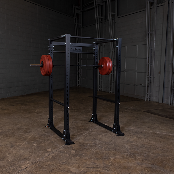 Body solid power rack with barbell and red bumper plates