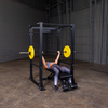 Woman doing incline bench press yellow bumper plates