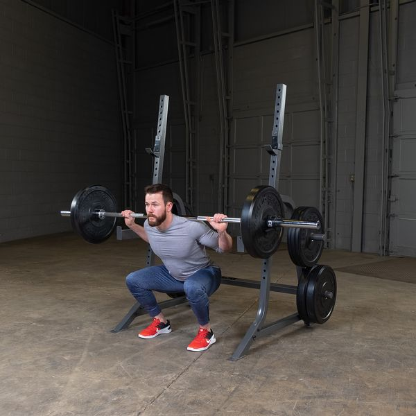man doing back squat on powerline squat rack