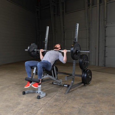 man doing incline bench press on powerline squat rack