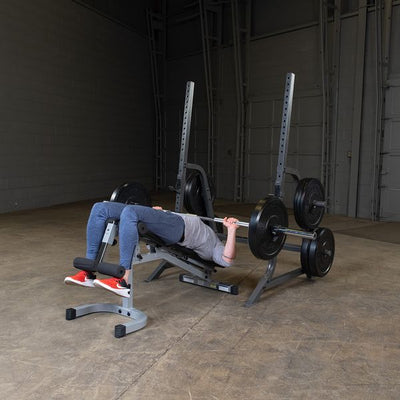 man doing decline bench press on powerline pmp150 with bumper plates