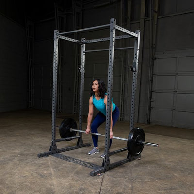 woman doing barbell rows in powerline power rack