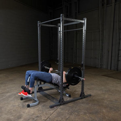 man doing decline bench press on powerline power rack