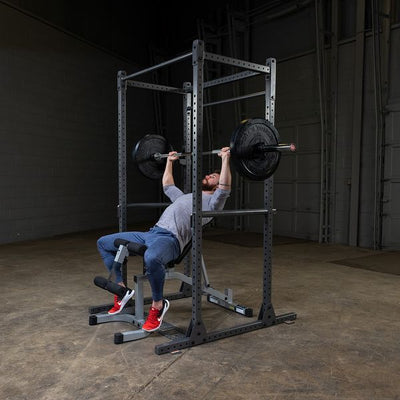 man doing incline presses on powerline power rack