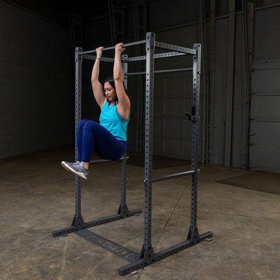 woman doing knee ups on powerline power rack ppr1000