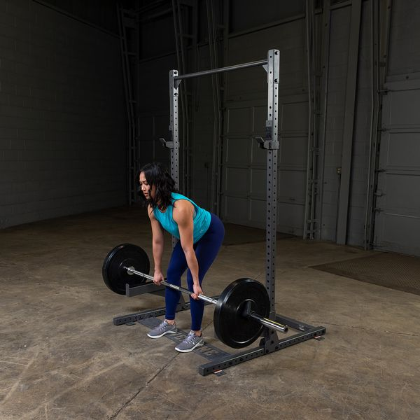 woman doing rack pulls on ppr500 using safety spotter arms