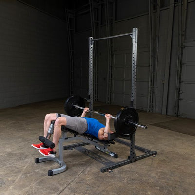 man doing decline bench press on ppr500 powerline half rack