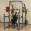 guy doing incline bench press on clubline commercial squat rack