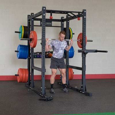 SPR1000 power rack with additional storage accessories with bumper plates