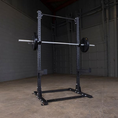 Body Solid SPR500 half rack black with pull-up bar, j-hooks, safety spotter barbell bumper plates