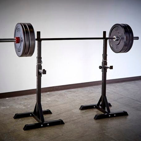 squat stand, olympic barbells and bumper plates