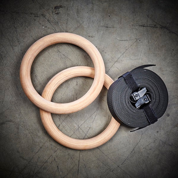 Wood gymnastic rings black straps tan wood color with numbered straps and heavy duty buckles