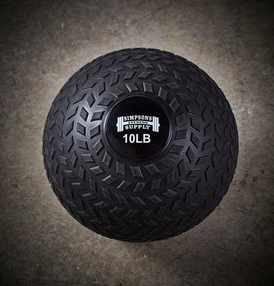 black rubber slam ball 20 pound with grip on exterior