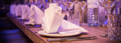 White napkin on white ceramic plate