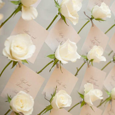 white roses with a escort card