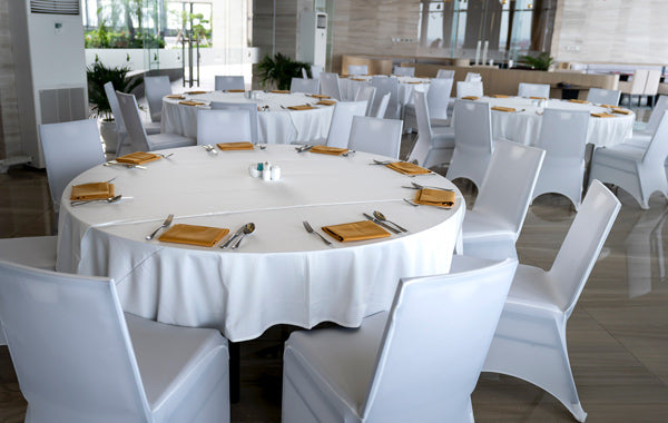 round white table with brown table napkin