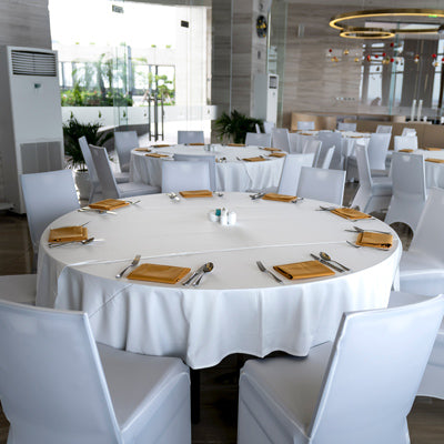white round tablecloth with a golden table napkin