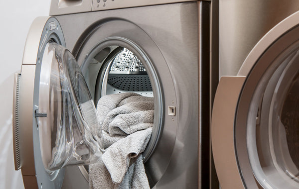 washing machine and gray towel