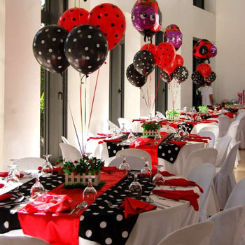 Red and black polka dot balloons