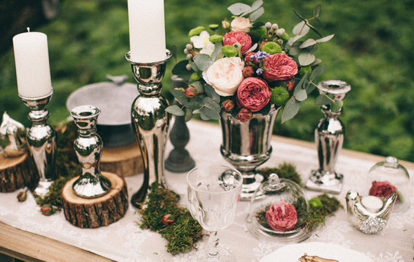 Silver candle holders on the table
