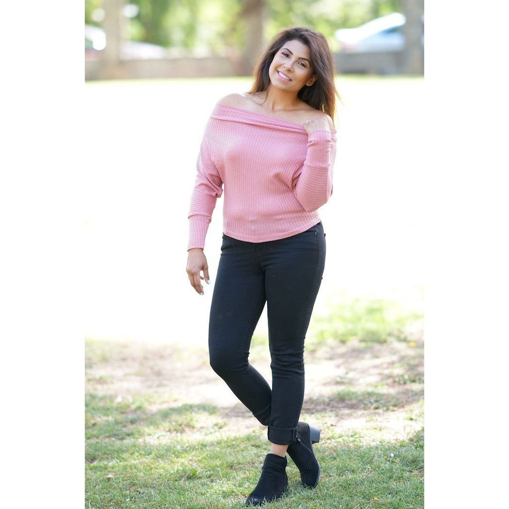 This top is a great transition item to have in your closet. With the thermal like material it is not to hot but a great item to layer. It can be worn off both shoulders or just one. Wear as a casual vibe or dress it up for a chill night out with friends.