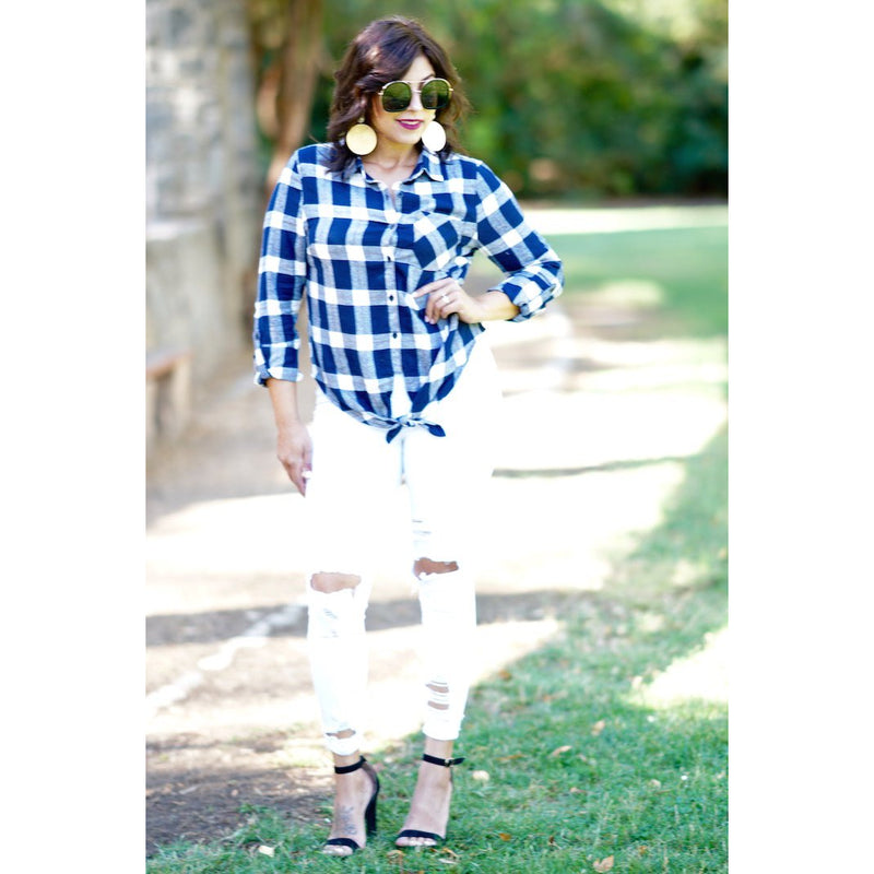 "Catching Flights top is a checkered plaid button down with a knot tie in the front. Pair this with our ""Made For Her"" jeans. This top  can be worn for a casual look.Sacramento Boutique"