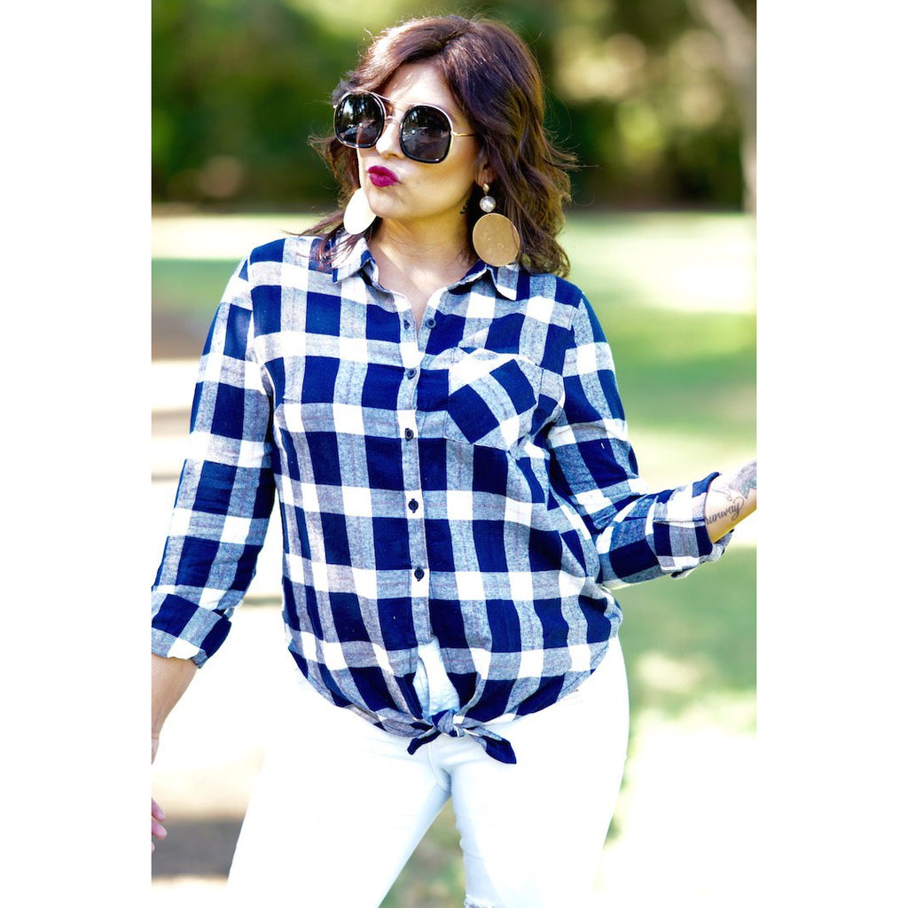 "Catching Flights top is a checkered plaid button down with a knot tie in the front. Pair this with our ""Made For Her"" jeans. This top  can be worn for a casual look. Sacramento boutique women"