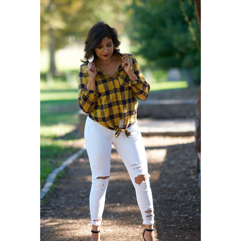 "Catching Flights top is a checkered plaid button down with a knot tie in the front. Pair this with our ""Made For Her"" jeans. This top  can be worn for a casual look. Sacramento boutique"