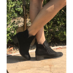 These booties have a high top with a zipper on the side and a low thick heel. The material has a suede like feel and breathable front with decorative holes.