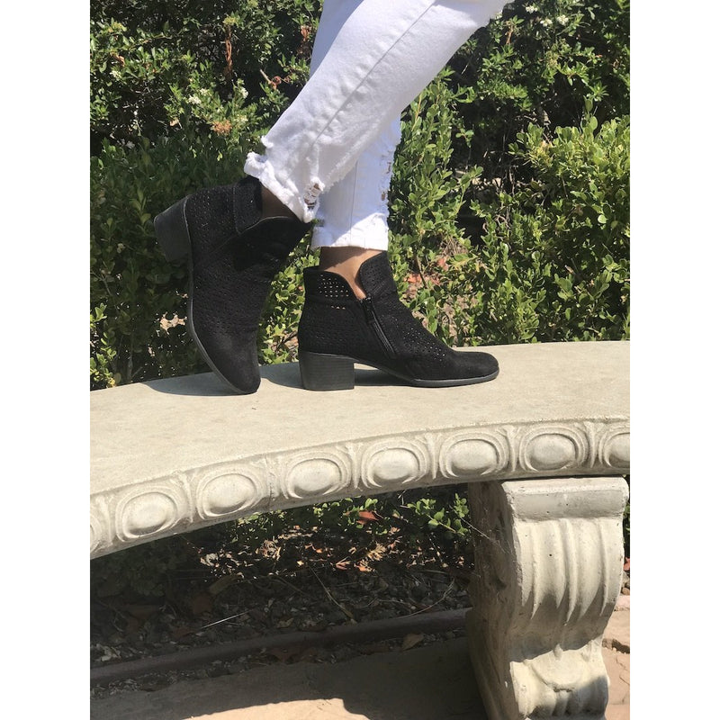 These booties have a high top with a zipper on the side and a low thick heel. The material has a suede like feel and breathable front with decorative holes.These booties have a high top with a zipper on the side and a low thick heel. The material has a suede like feel and breathable front with decorative holes.