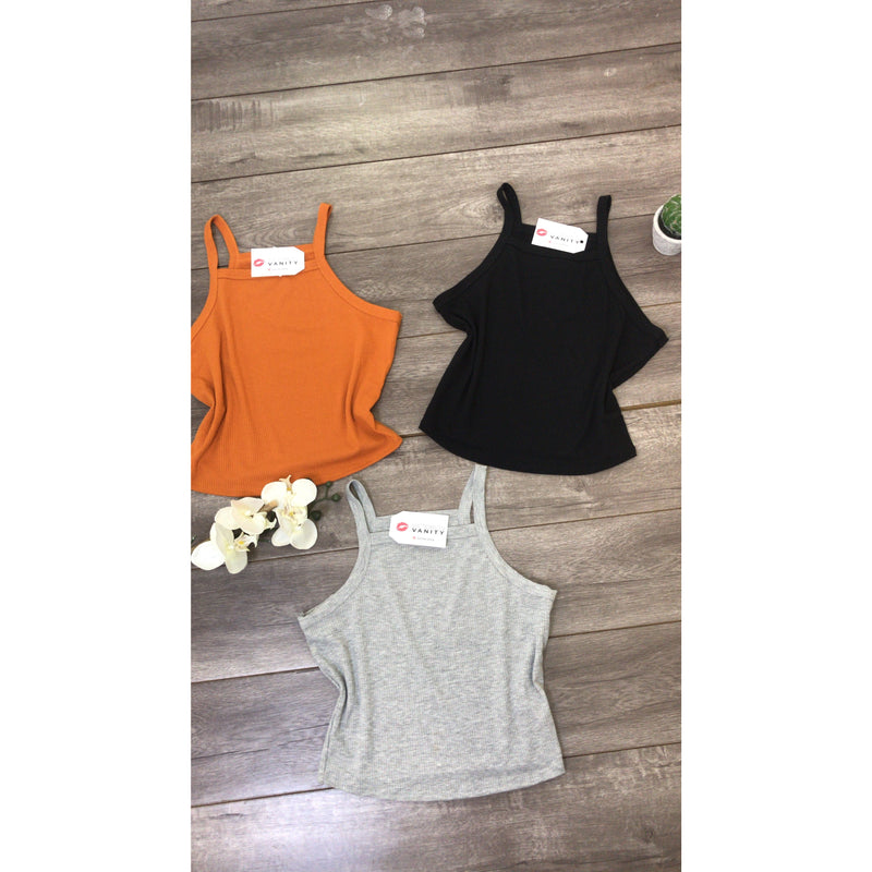 "These cute and trendy knit ribbed top is such a must for your closet this spring/summer! It has a halter neck line and a cropped hem. This top is very versatile and can be paired with just about any bottom.   How It Fits: ""True to size with a good stretch. It does have a cropped hem which come directly to the waist of your bottoms. If you would like it to fit looser order a size up."