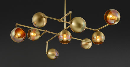 Lightmaker Studio presents geometric brass lighting at IDS Toronto