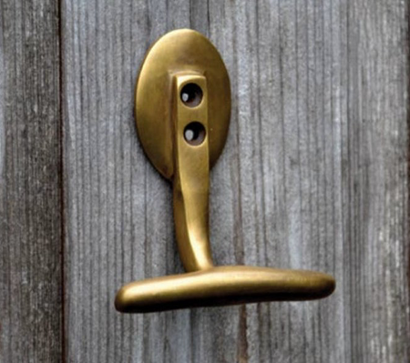 Brass wall and door hooks. Folding back plate for space saving projects.