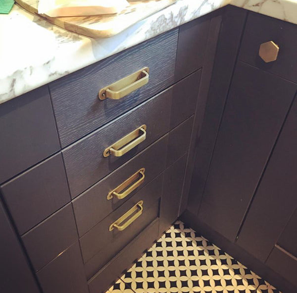 Brass kitchen drawer pulls. Pretty art deco styled pulls and cabinet handles . Solid and supplied with fitting screws.