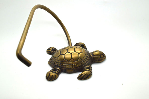 Toilet roll holder, solid brass turtle design loo roll holder. Supplied with fitting screws. Different designs in store.