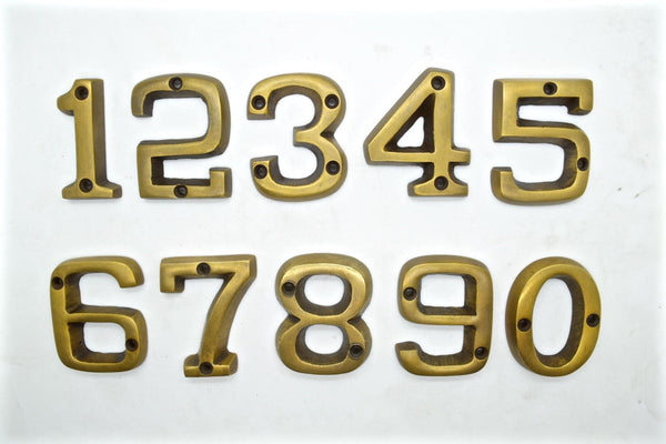 Brass house numbers. Solid cast brass with an art deco style . 1-9 available supplied with screws.