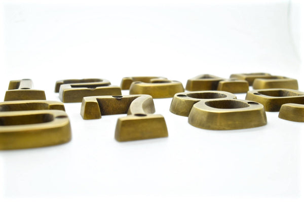Brass house numbers. Solid cast brass with an art deco style