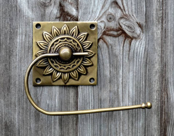 Brass toilet roll holder. Square backed flower design by The Foundryman.