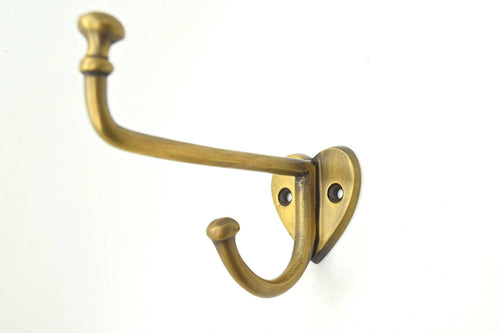 Brass wall and door hooks. Long heart based brass hook. Great for hat and coat hooks. Solid supplied with screws.