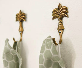 "Palm tree wall hooks 3.5"" long in solid brass. Supplied with fitting screws."