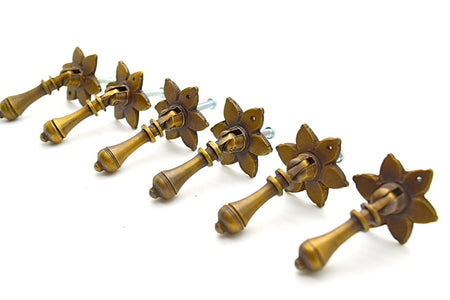 Brass handles and pulls. Solid cast brass . Many designs in store. Supplied with fitting screws, 2 finishes available