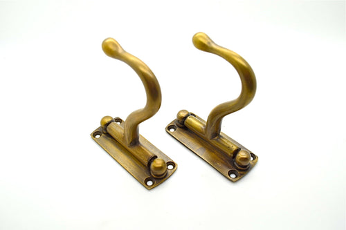 Brass wall and door hooks. Folding hooks. Perfect for interior makeover projects. Comes with screws.